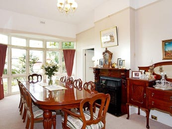 Classic dining room idea with floorboards & sash windows - Dining Room Photo 166019