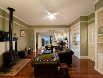 Open plan living room using brown colours with laminate & built-in shelving - Living Area photo 214451