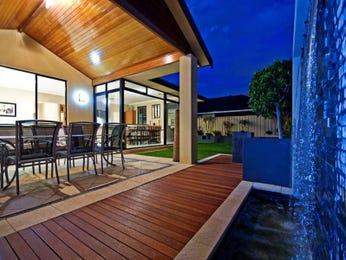 Walled outdoor living design with deck & decorative lighting using grass - Outdoor Living Photo 357203