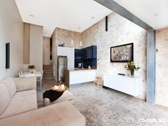 Split-level living room using cream colours with stone & ceiling skylight - Living Area photo 214949