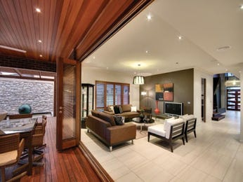 Open plan living room using beige colours with floorboards & bi-fold doors - Living Area photo 215418