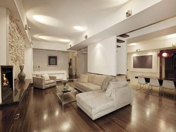 Open plan living room using white colours with floorboards & bi-fold doors - Living Area photo 447242