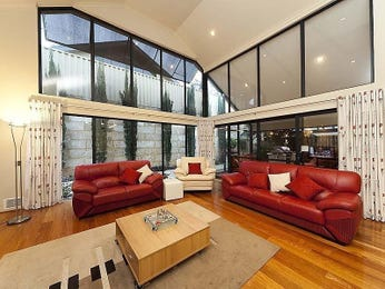 Open plan living room using red colours with floorboards & floor-to-ceiling windows - Living Area photo 7010285