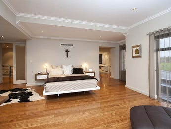 Retro bedroom design idea with carpet & louvre windows using brown colours - Bedroom photo 216713