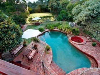 In-ground pool design using brick with pool fence & outdoor furniture setting - Pool photo 450392