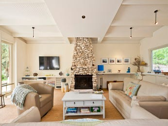 Open plan living room using beige colours with stone & built-in shelving - Living Area photo 17234041