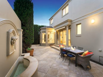 Walled outdoor living design with outdoor dining & fountain using slate - Outdoor Living Photo 15448037