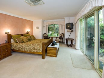 Country bedroom design idea with carpet & french doors using brown colours - Bedroom photo 222758