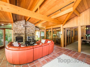 Open plan living room using orange colours with exposed brick & exposed eaves - Living Area photo 7186301