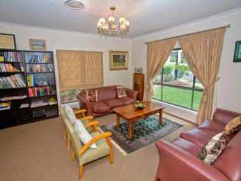Brown living room idea from a real Australian home - Living Area photo 409688