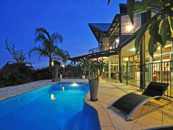Endless pool design using natural stone with verandah & decorative lighting - Pool photo 464015