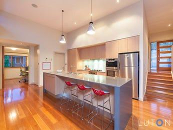 Modern open plan kitchen design using floorboards - Kitchen Photo 7445657