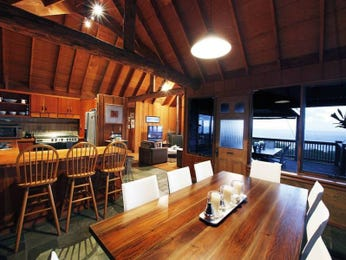 Country dining room idea with hardwood & exposed eaves - Dining Room Photo 7443381