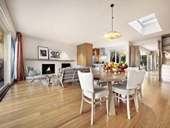Modern dining room idea with floorboards & fireplace - Dining Room Photo 226832