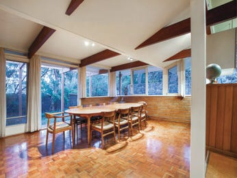 Modern dining room idea with timber & exposed eaves - Dining Room Photo 7801465