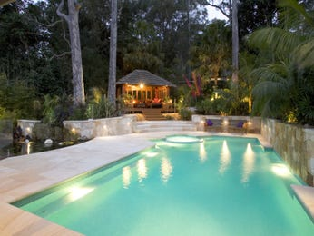 In-ground pool design using natural stone with cabana & ground lighting - Pool photo 227930