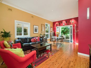Open plan living room using red colours with floorboards & floor-to-ceiling windows - Living Area photo 15801733