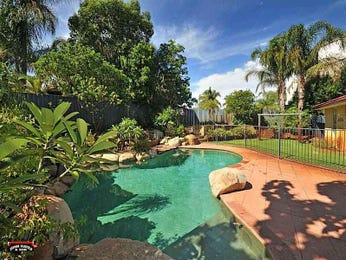 Freeform pool design using grass with pool fence & rockery - Pool photo 353606
