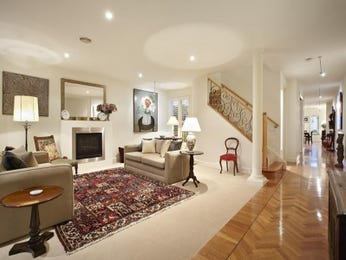 Open plan living room using beige colours with carpet & fireplace - Living Area photo 1486252