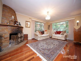 Open plan living room using brown colours with carpet & bay windows - Living Area photo 437419