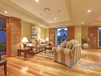 Dining-living living room using beige colours with carpet & bi-fold doors - Living Area photo 1260191