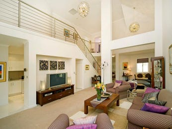 Open plan living room using silver colours with carpet & staircase - Living Area photo 491100