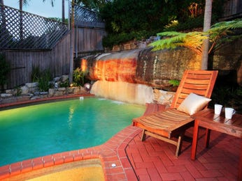 Low maintenance pool design using tiles with pool fence & outdoor furniture setting - Pool photo 471231