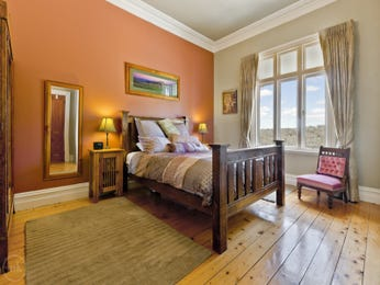 Classic bedroom design idea with floorboards & french doors using brown colours - Bedroom photo 961568