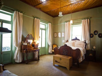 Period bedroom design idea with hardwood & french doors using green colours - Bedroom photo 279463