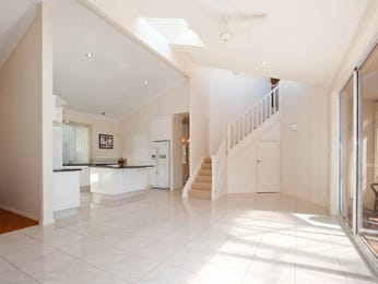 Open plan living room using white colours with tiles & staircase - Living Area photo 1497879