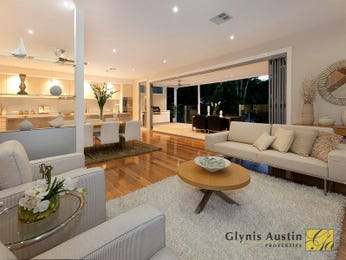 Open plan living room using cream colours with carpet & bi-fold doors - Living Area photo 1469509