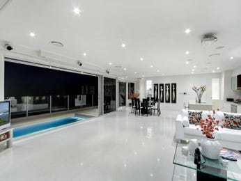 Dining-living living room using cream colours with tiles & bi-fold doors - Living Area photo 281457
