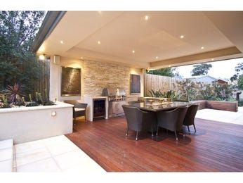Walled outdoor living design with bbq area & decorative lighting using brick - Outdoor Living Photo 429541