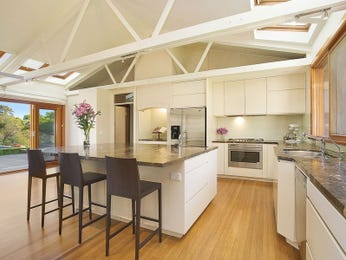 Modern island kitchen design using floorboards - Kitchen Photo 511961
