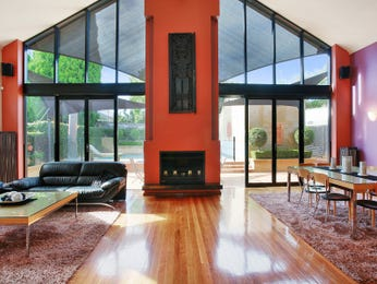 Open plan living room using red colours with floorboards & fireplace - Living Area photo 8666257