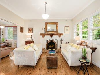 Open plan living room using white colours with floorboards & fireplace - Living Area photo 15244893