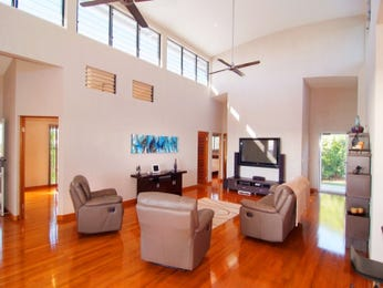 Open plan living room using brown colours with floorboards & louvre windows - Living Area photo 1213727