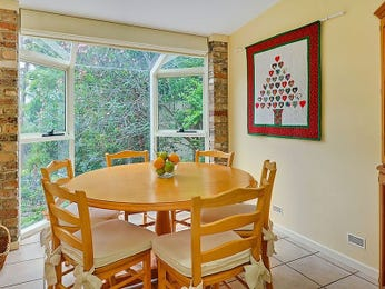 Country dining room idea with exposed brick & bay windows - Dining Room Photo 873690