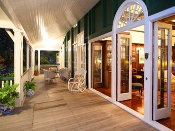 Indoor-outdoor outdoor living design with deck & decorative lighting using timber - Outdoor Living Photo 339811