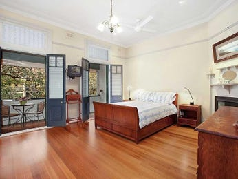 Classic bedroom design idea with floorboards & balcony using brown colours - Bedroom photo 483155