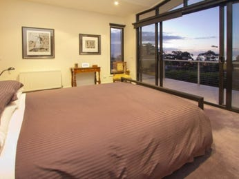 Beige bedroom design idea from a real Australian home - Bedroom photo 575419