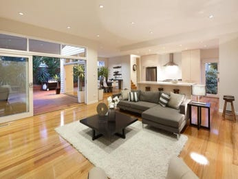 Open plan living room using brown colours with hardwood & floor-to-ceiling windows - Living Area photo 1234107