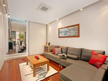 Open plan living room using grey colours with hardwood & staircase - Living Area photo 759972