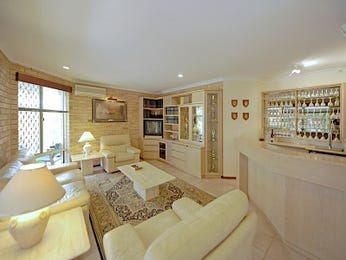 Split-level living room using cream colours with carpet & bar/wine bar - Living Area photo 590722