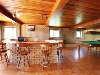 Country dining room idea with exposed brick & bar/wine bar - Dining Room Photo 651535