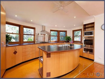 Modern l-shaped kitchen design using floorboards - Kitchen Photo 1362373