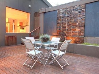 Walled outdoor living design with deck & decorative lighting using grass - Outdoor Living Photo 531666
