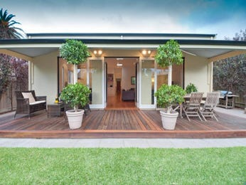 Multi-level outdoor living design with bbq area & decorative lighting using grass - Outdoor Living Photo 1161764
