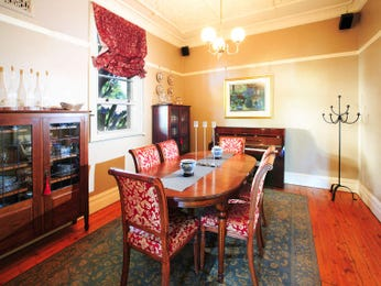 Classic dining room idea with floorboards & sash windows - Dining Room Photo 496235