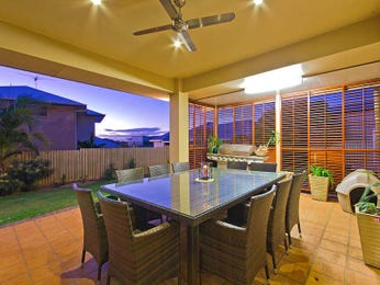 Indoor-outdoor outdoor living design with outdoor dining & latticework fence using tiles - Outdoor Living Photo 697857